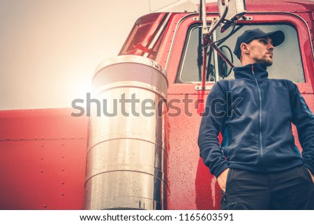 Semi Truck Driving Job. Caucasian Men in Front of the Red Truck.