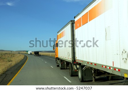 Semi truck going fast on interstate highway #5247037