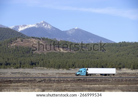 Semi truck going fast on mountain highway