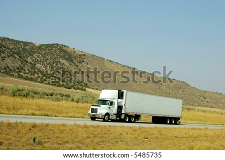 Semi truck going up hill on interstate highway