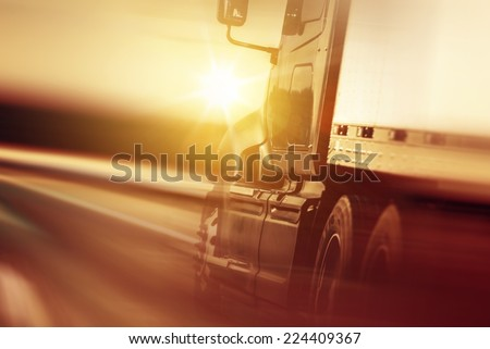 Semi Truck In Motion. Speeding Truck on the Highway. Trucking Business Concept #224409367