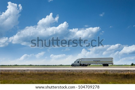 Semi truck on the road transporting cargo - stock photo