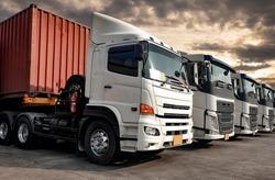 Semi-truck trailer a parking lot at sunset sky. Road freight cargo truck transportation. Logistics truck.