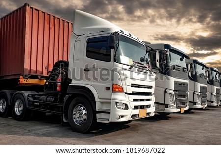 Semi-truck trailer a parking lot at sunset sky. Road freight cargo truck transportation. Logistics truck. ストックフォト ©
