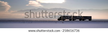 Semi Truck Travels Highway Over Salt Flats Freight Transport #258616736