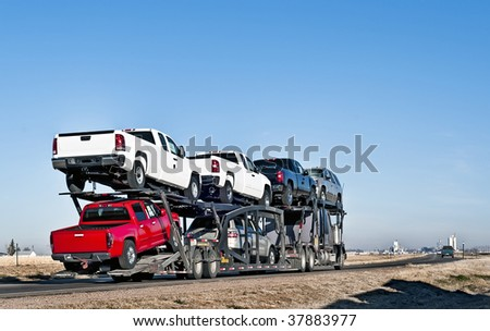 Semi-truck with car hauler or sometimes called a traveling parking lot. #37883977