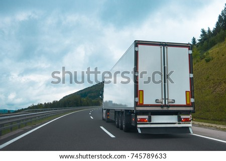 Semi truck with trailer on highway road #745789633