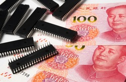 Semiconductor chips shortage and high price. Pile of computer chips and spread of  Chinese Yuan banknotes. Concept for crisis in the industry.