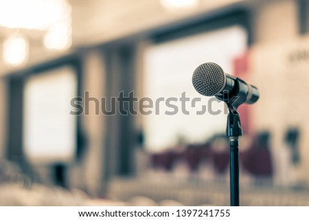 Seminar, speech presentation, town hall meeting, in convention lecture hall or business conference room in corporate or community event for host or public hearing with microphone voice speaker