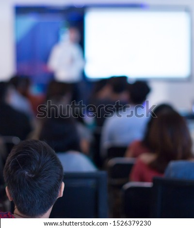 Seminar with expert speaker presenting to audience in hall. Business presentation at forum. Executive presenter giving a speech. Leadership training coach in workshop lecture.  #1526379230