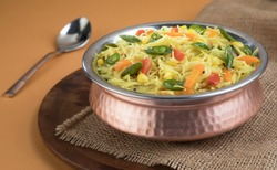 Semiya Upma or Vermicelli Uppuma or uppittu is a popular breakfast menu from south India. served in a bowl on wooden plate. selective focus