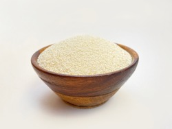 Semolina isolated on white background, raw semolina in wooden bowl