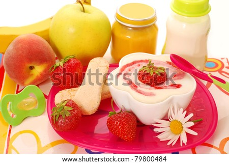 semolina porridge dessert with  strawberries  ,fruits and other food for baby