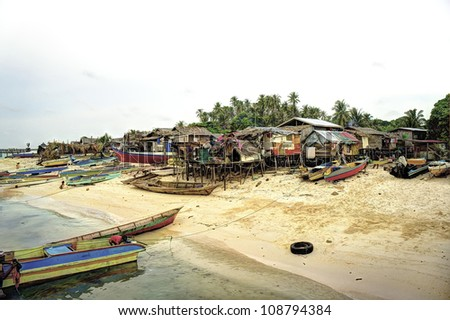 SEMPORNA, MALAYSIA - JUN 29: The village atmosphere of local sea gypsy (bajau) Jun 29, 2012 in Semporna, Sabah, Malaysia. Children live here do not attend school for lack of means and resources.