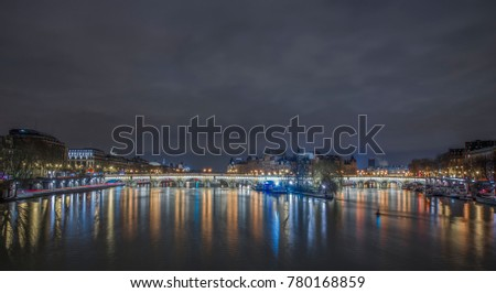 Shutterstock Sena river in Paris at night, light reflections