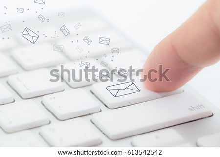 Sending email. gesture of finger pressing send button on a computer keyboard - Selective Focus.