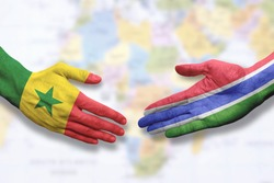 Senegal and Gambia - Flag handshake symbolizing partnership and cooperation