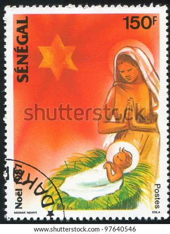 SENEGAL - CIRCA 1987: A stamp printed by Senegal, shows Madonna and child, circa 1987