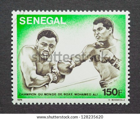 SENEGAL � CIRCA 1976: postage stamp printed in Senegal showing an image of the fight between Muhammad Ali vs Joe Frazier in 1971 for the Heavyweight Championship, circa 1976.