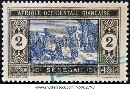 SENEGAL - CIRCA 1914: stamp printed by Senegal, shows Senegalese Preparing Food, circa 1914