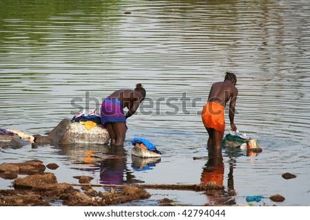SENEGAL - FEBRUARY 14: African women comes to wash into the river, the villages have no running water, February 14, 2007 in Country Bassari, Senegal.