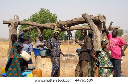 SENEGAL - FEBRUARY 13: All the people working in the extraction of water from the well in the Peul ethnic village on February 13, 2007 near Wassadou, Senegal.
