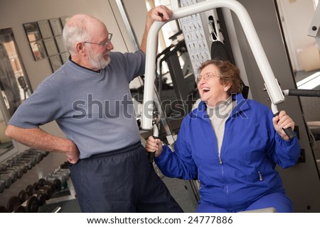 Senior Adult Couple Working Out in the Gym.
