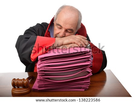 Senior adult judge exhausted from workload fell asleep - stock photo