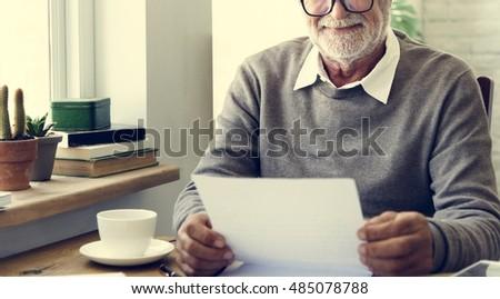 Senior Adult Reading Letter Concept #485078788