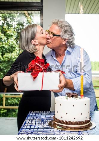 Senior adutls couple celebrating birthday at home Stock photo ©