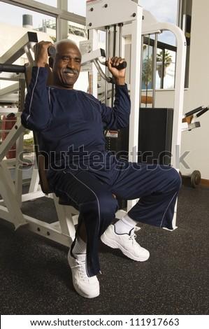 Senior African American man exercising in gym