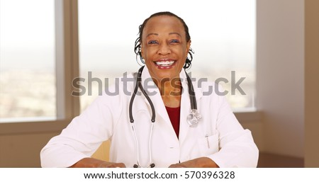 Senior African doctor smiling at camera
