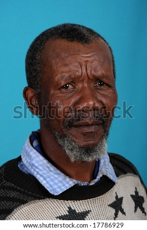 Senior African man with beard and sad expression