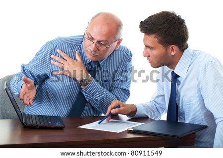 senior and junior businessman discuss something during their meeting, both look at netbook screen, isolated on white