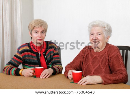 Senior and mature womans drinking caffee and smiling