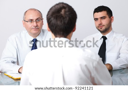 Senior and young colleague interview candidate for a job