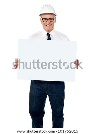 Senior architect holding blank billboard wearing white hardhat