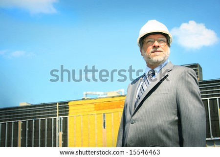 Senior architect on building site - stock photo