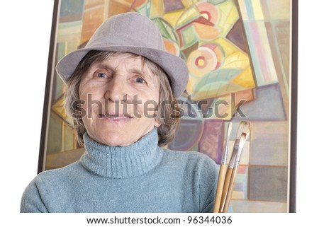 senior artist woman in front of painting
