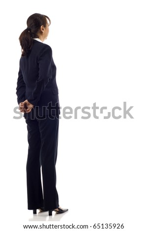 Senior Asian business woman from the back - looking at something over a white background