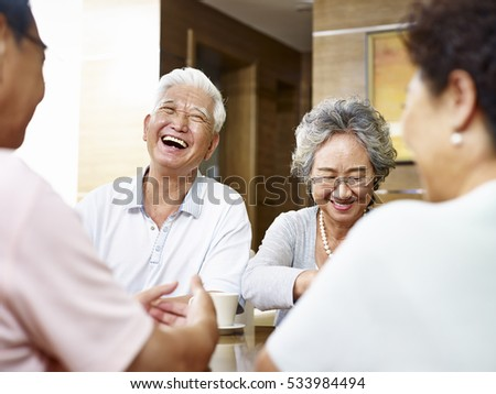 senior asian people getting together and having a good time