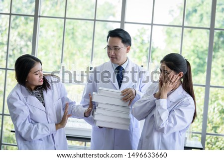 Senior asian scientist has assigning new job to students in laboratory. #1496633660