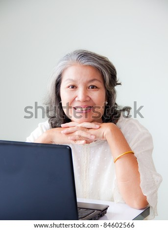 senior asian woman smiling with notebook