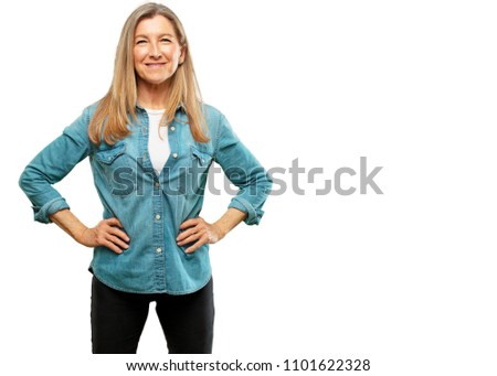 senior beautiful woman smiling proudly and confidently with arms hands on hips in akimbo pose, happy and sure of success, giving an
