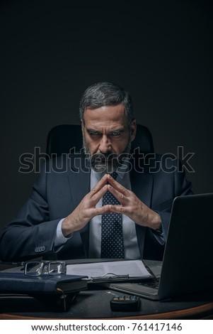 Senior boss, evil corporate overlord in the dark ストックフォト ©