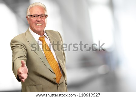 Senior Business Man Offering Handshake, Indoor