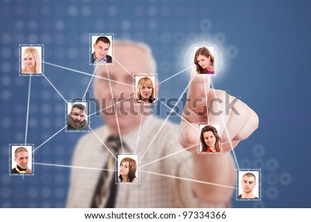 Senior business man pressing Social network pictures - stock photo