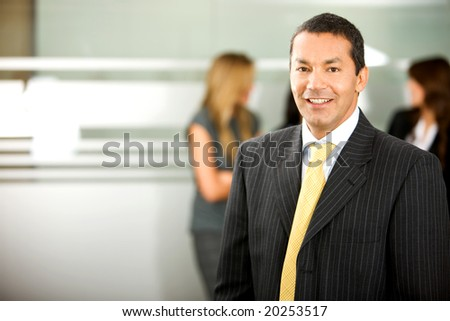 senior business man smiling in an office