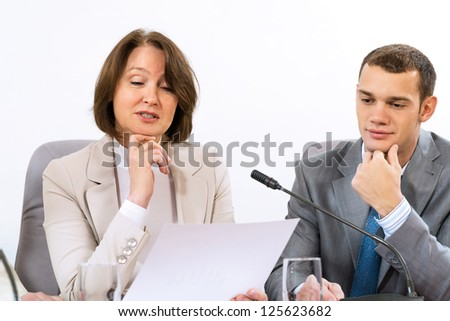 Senior business woman working with documents at the conference, on the table microphone stand