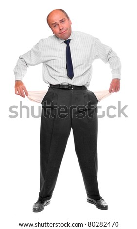 Senior businessman bankrupt, his hands with two empty pockets.